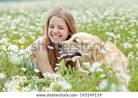 Beautiful woman playing with her ??dog. Outdoor portrait. series - stock photo