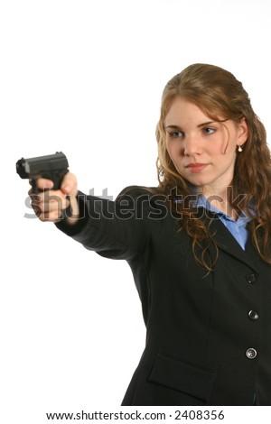 Beautiful woman pointing a handgun - stock photo