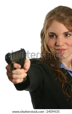 Beautiful woman pointing handgun - stock photo