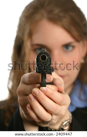 beautiful woman pointing handgun with gun in focus - stock photo