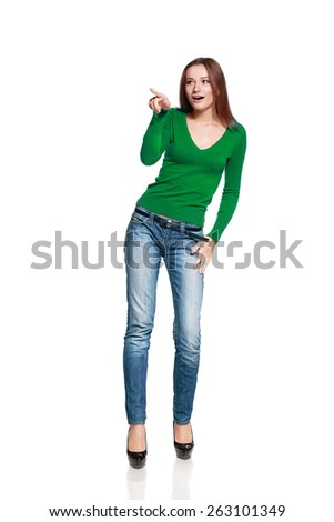 Beautiful woman pointing  - isolated over a white background - stock photo