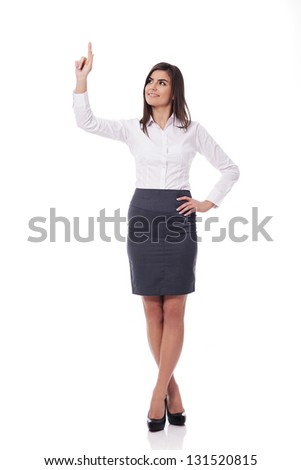 Beautiful woman pointing on white
