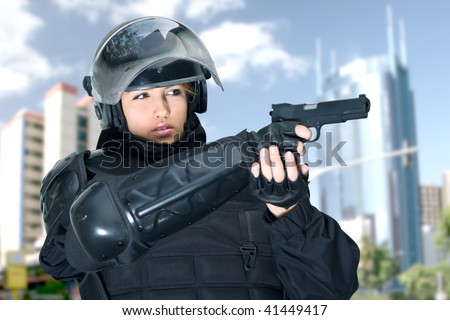 Beautiful Woman, Police Officer in complete intervention equipment ready to action.