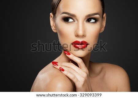 Beautiful woman portrait, beauty on dark background, red nails - stock photo
