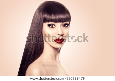 Beautiful woman portrait. Beauty Spa woman with perfect fresh clear skin and perfect makeup. Pure Beauty brunette model girl over beige background. Youth and Skin Care Concept. Long Straight Hair.  - stock photo