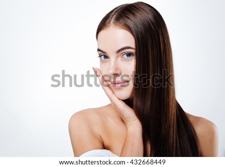 Beautiful woman portrait face with long healthy hair studio isolated on white - stock photo
