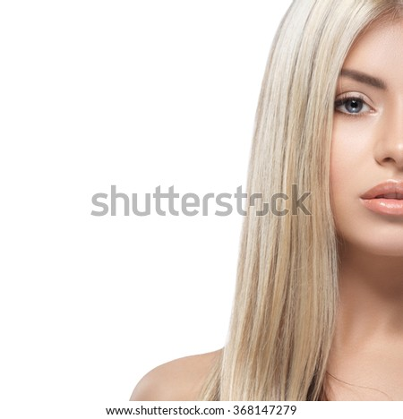 Beautiful woman portrait half-face studio isolated on white