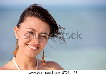 Beautiful woman portrait in a windy day outdoors