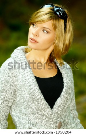 Beautiful woman portrait in autumn outdoors