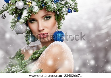 Beautiful woman portrait  in creative christmas  image. - stock photo