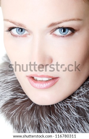 beautiful woman portrait in furs of silver fox, mid adult female face and shoulders closeup, isolated on white background