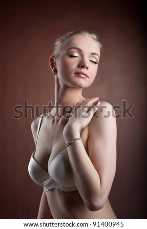 Beautiful woman portrait in white bra - stock photo