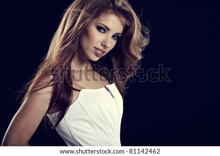 Beautiful woman portrait on black - stock photo