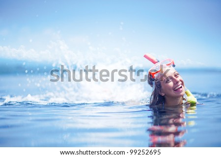 Beautiful woman portrait on the beach wearing snorkeling equipment, water sport, healthy lifestyle concept - stock photo