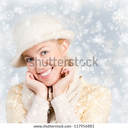 Beautiful woman portrait over a snowy background - stock photo