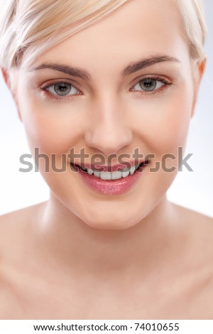 beautiful woman portrait over blue white - stock photo