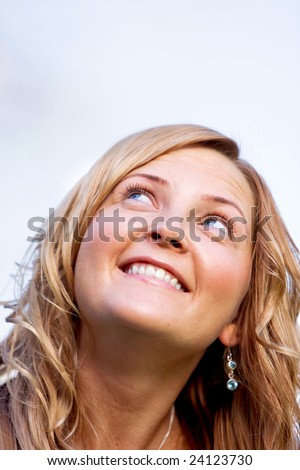 beautiful woman portrait smiling and looking up - stock photo