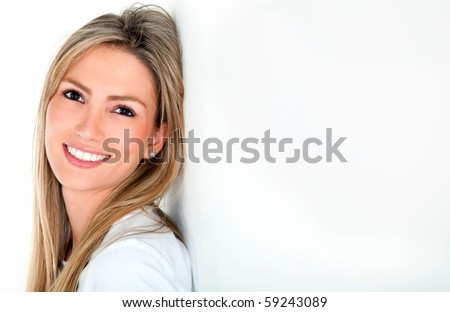 Beautiful woman portrait smiling over a white background - stock photo
