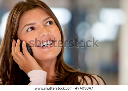 Beautiful woman portrait talking on the phone