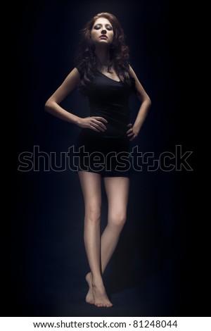 beautiful woman portrait wearing black dress - stock photo