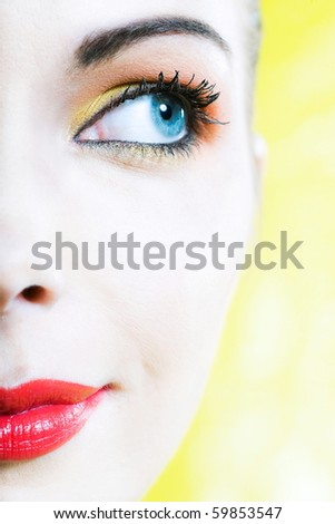 beautiful woman portrait with colorful make-up  and background - stock photo