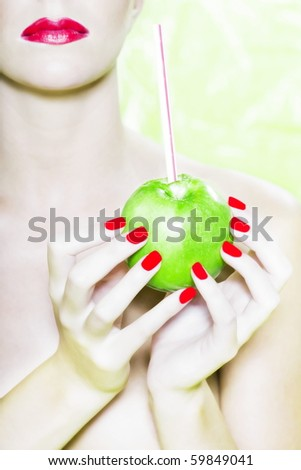 beautiful woman portrait with colorful make-up  and background drinking apple juice with straw - stock photo