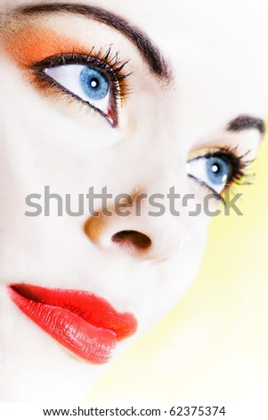 beautiful woman portrait with colorful makeup  and background - stock photo