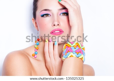 beautiful woman portrait with colorful makeup and nail polish, studio white - stock photo