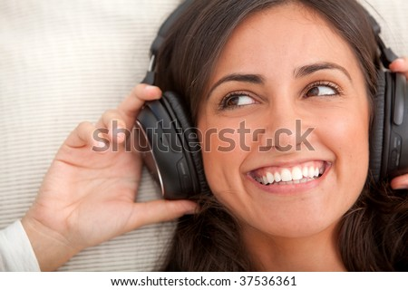 Beautiful woman portrait with earphones and smiling