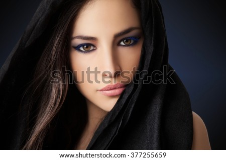 beautiful woman portrait with expressive look, studio