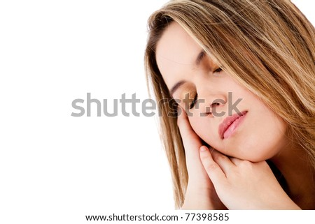 Beautiful woman portrait with eyes closed sleeping - isolated over white - stock photo