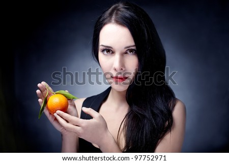 beautiful woman portrait with fruit - stock photo