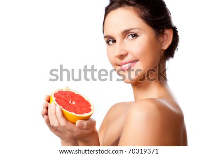 beautiful woman portrait with half of grapefruit - stock photo