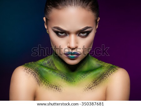 beautiful woman portrait with imitation snake skin on the neck