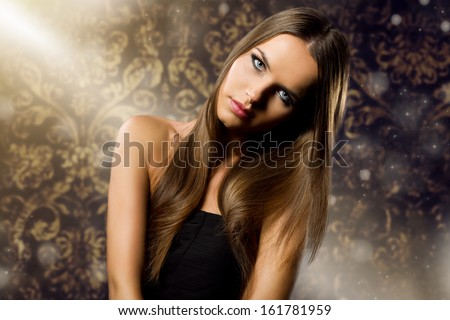beautiful woman portrait with long healthy hair against retro glitter background