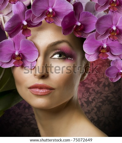 Beautiful Woman Portrait With Orchid flowers over black - stock photo