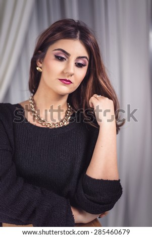Beautiful woman portrait with professional make up. Model wearing black knitted sweater - stock photo