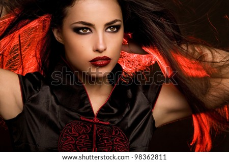 beautiful woman portrait with red lips and hair back light, studio closeup - stock photo