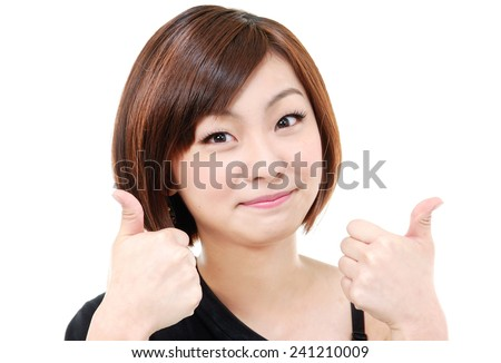 Beautiful woman porttrait showing thumbs up - stock photo