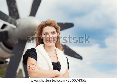 beautiful woman posing against plane