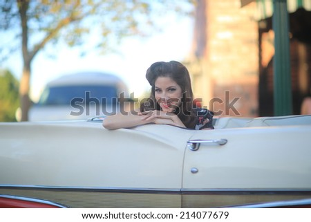 Beautiful Woman Posing and and Around a Vintage Car