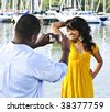 Beautiful woman posing for vacation photo at harbor - stock photo