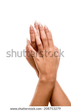 Beautiful woman posing hands over white background - stock photo