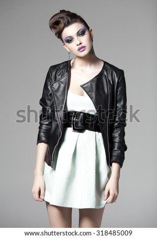 beautiful woman posing in a leather jacket - stock photo