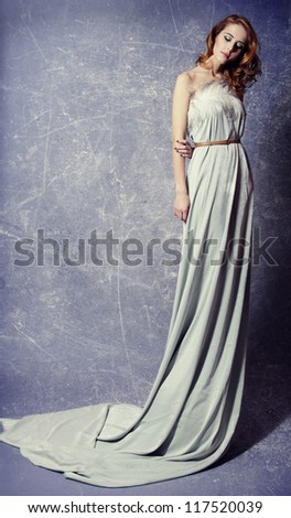 Beautiful woman posing in a long dress