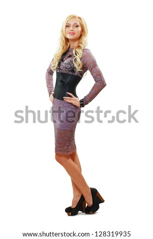 Beautiful woman posing in lace dress - stock photo