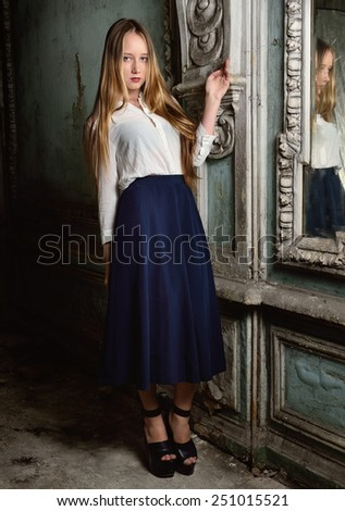 beautiful woman posing in obsolete interior. Studio with interior of old palace. Not necessary property release. - stock photo