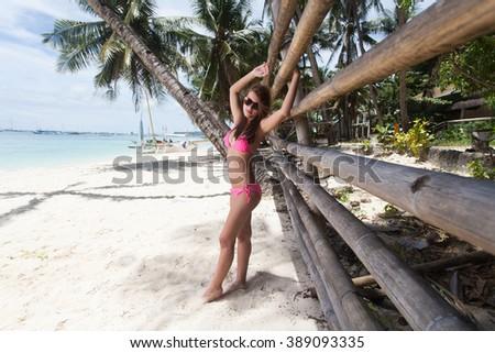 Beautiful woman posing on a paradise beach - stock photo