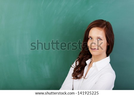 Beautiful woman posing over the green board
