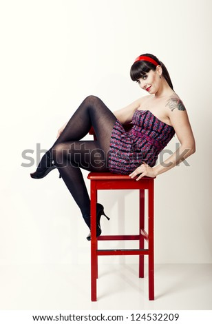 Beautiful woman posing sitting on a chair